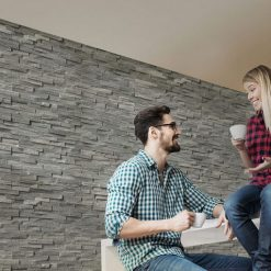 Masonry grey wall panels with couple in front