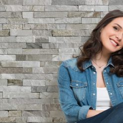 Woman sitting in front of Dumapan smp valladolid light grey wall panels