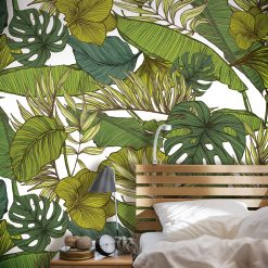 Room decorated in green monstera leaf wall panels